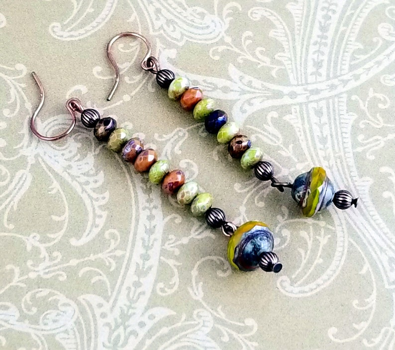 NE275 Beautiful Faceted Czech Beads in Colors of Browns Greens and Blues Highlight this Pair of Copper Dangle Drop Earrings