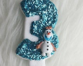 Frozen Olaf glitter birthday number candle baby blue, comes in any number you like