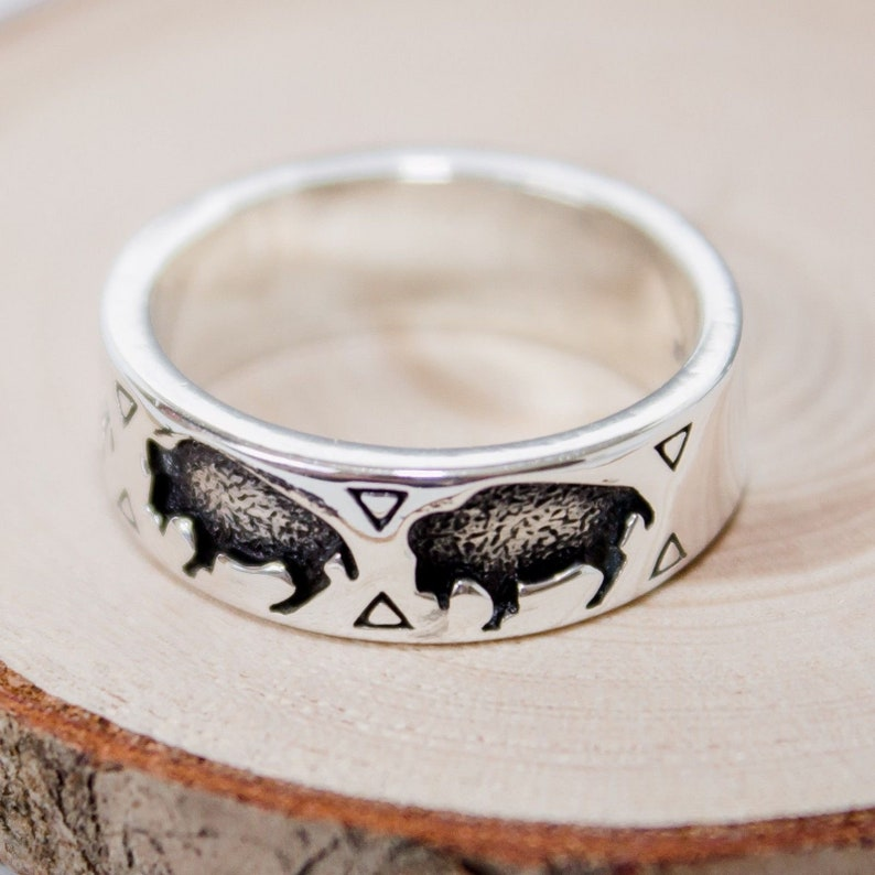 Sterling silver band style ring with stamped Buffalos shadowboxed