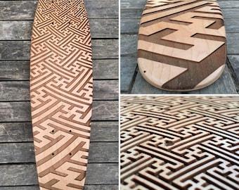 "Maple 22"" mini cruiser skate deck with sayagata pattern engraved."