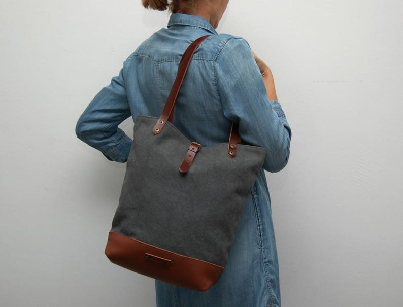 Tote bag waxed canvas charcoal color leather bottom in tan color,with  handles and closures in leather