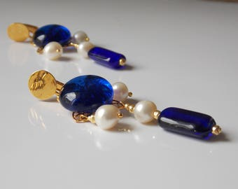 Clip earrings dangle, freshwater pearls in soft white and indigo blue glass cabochon.