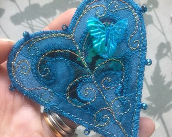 Heart brooch/pin in Liberty print and silk 7cm wide.