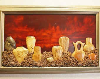 Woodcarving of various woods as Southwest Wooden Pottery in a framed picture wall hanging. Depicting Native Style artwork.