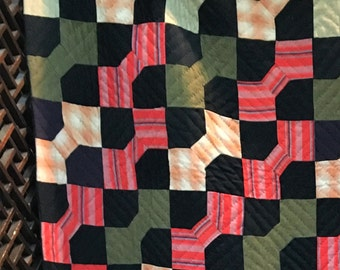 Antique orange, black and olive bowtie quilt