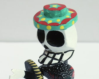 Wooden skeleton Day of the Dead, Dia de Muertos, holding basket