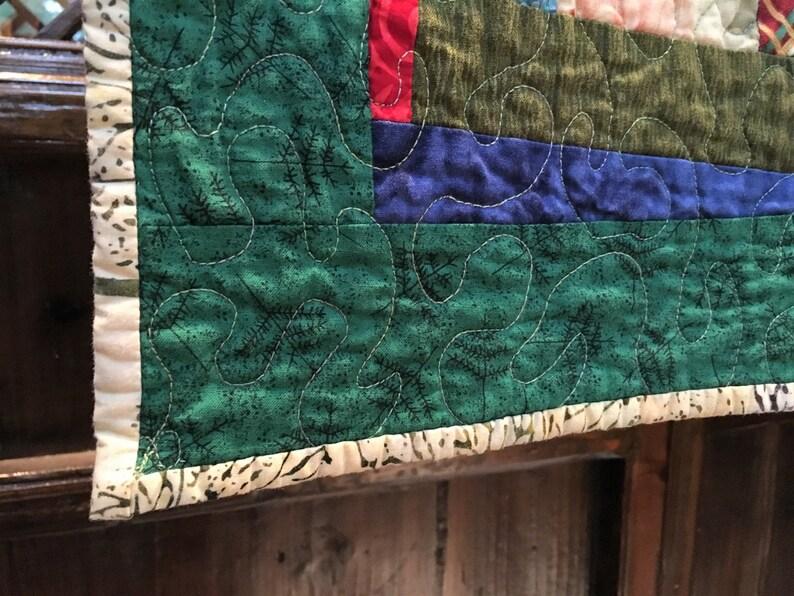 Modernized log cabin small quilt
