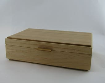 Jewelry box in cherry wood  12 X 7 3/4 x 3 3/8.Top is made from vertical grain ( quarter cut )