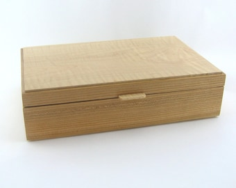 Tea box in cherry on the side ,size is 12 X 7 3/4 x 3 1/4.Top is made from Figured Maple item 197