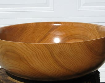 Cherry salad bowl. Finish  with oil  18 1/2 in in diameter by 6 5/8   in in height