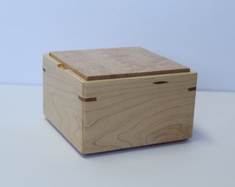 Wooden storage box, empty pocket, wooden box, handcrafted, cover in birds eyes maple and the  sides natural maple