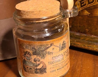 Vintage style Apothecary cocaine toothache drops label on bottle with spoon