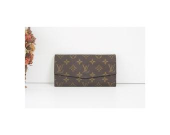 5cf7769910a61 80 s Louis Vuitton Monogram Long Wallet