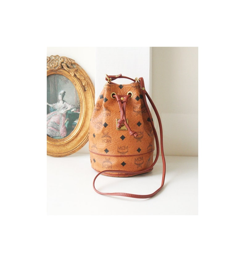 b46a0f0bb942 MCM Visetos Cognac Monogram Brown Authentic Vintage Drawstring