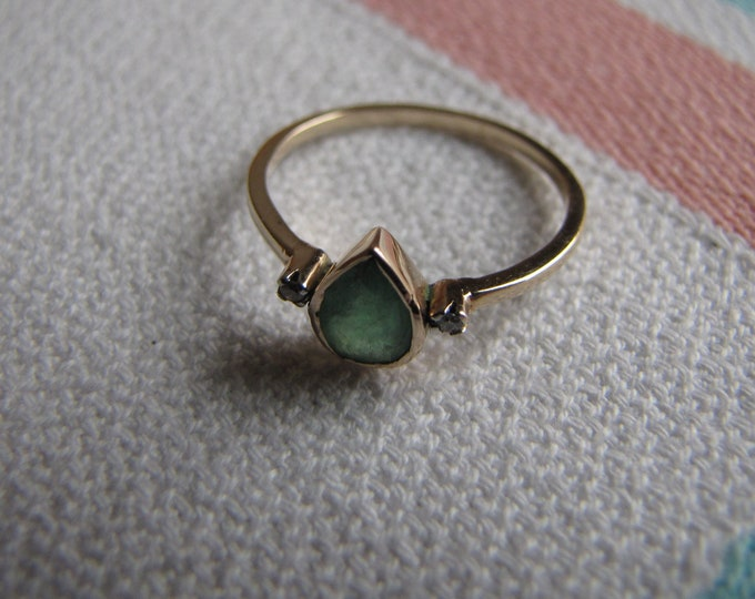 Small Gold Toned Ring with Green Stone and Promotional Diamonds