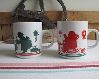 Mr. and Mrs. Santa coffee mugs Avon Silhouettes 1984