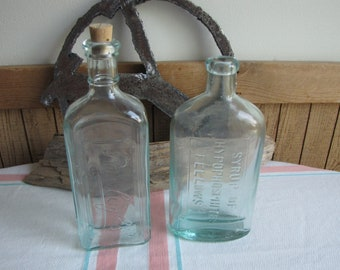 Old bottles set of 2 Rawleigh and Fellows Syrup