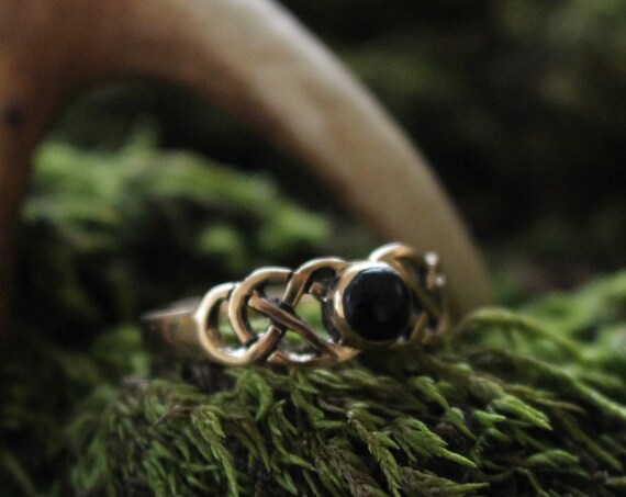 celtic knotwork ring with stone
