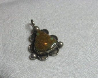 M-225 Small Turquoise Handmade sterling silver Pendant; southwest style. Weighs 9.2 grams. Excellent never used condition.