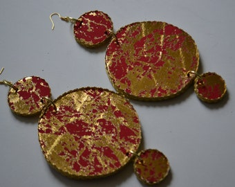 Gold spattered red circle earrings