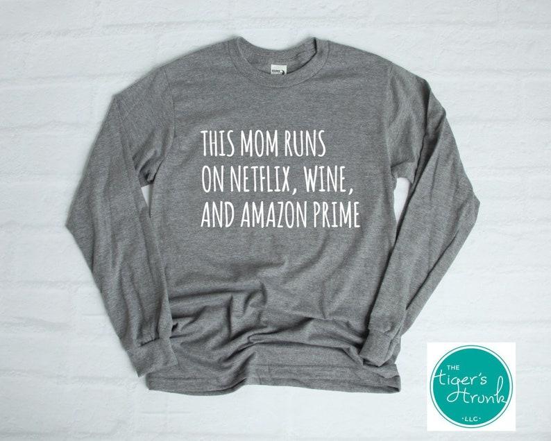 5fb0c3c3afd Funny Mom Shirts This Mom Runs on Netflix Wine   Amazon
