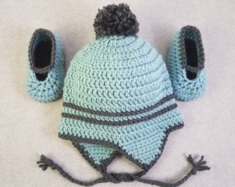 Baby hat with earflaps and matching booties