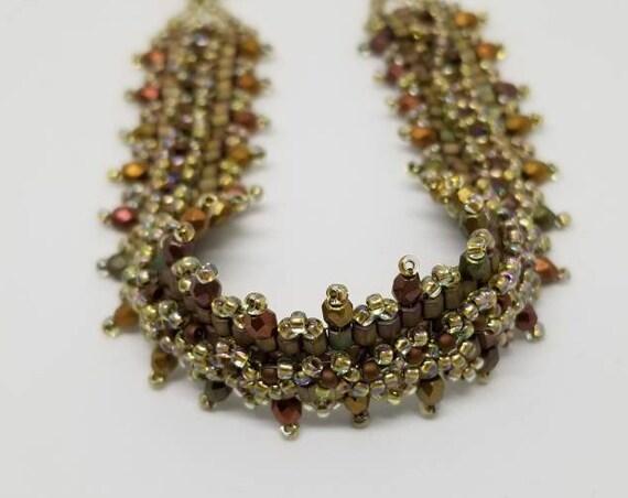 Green and gold beadwork bracelet Rita Caldwell