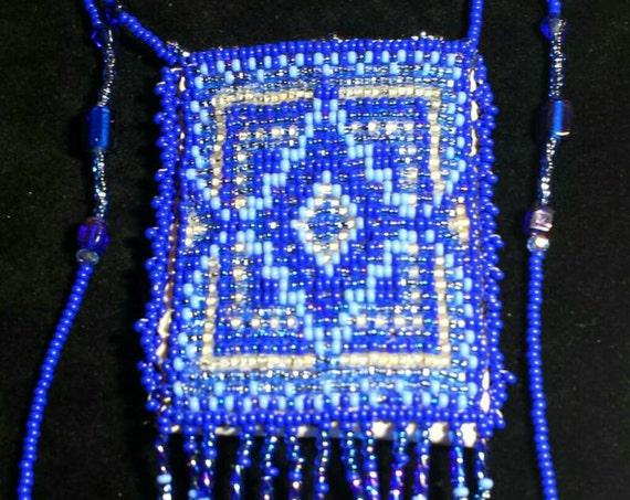 Sky blue waters Amulet Bag. Native American inspired Beadwork Dreams Raven.
