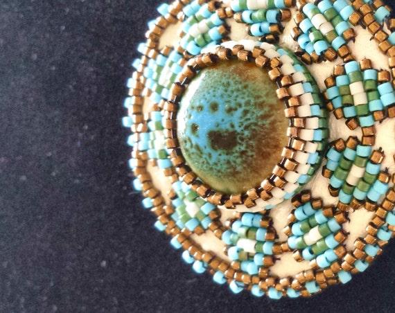 Occhio Beaded southwestern diamond pendant, Native American Inspired beadwork, Native American jewelry. Beadworkdreamsraven