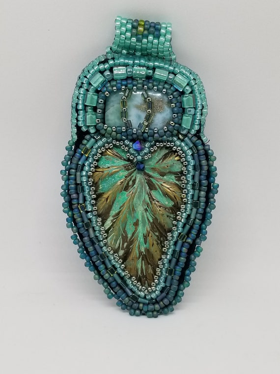 Leaves in blue waters Native American inspired Rita Caldwell
