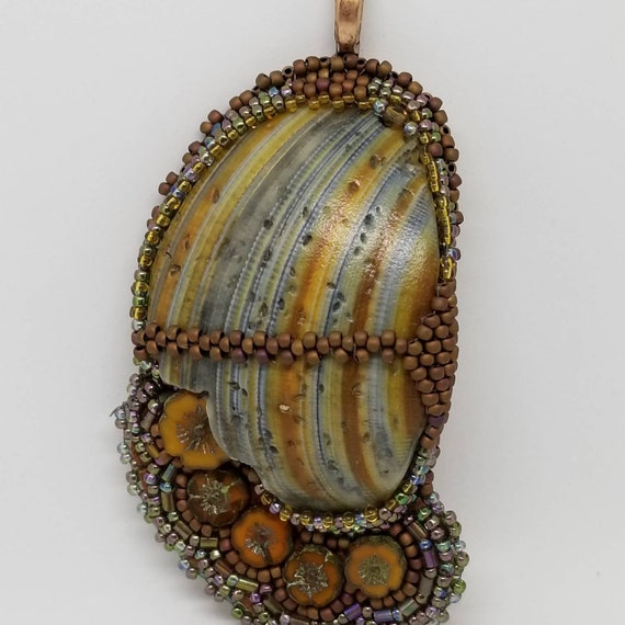 Bronze flowers from  the Sea pendant Rita Caldwell Native American inspired beadwork