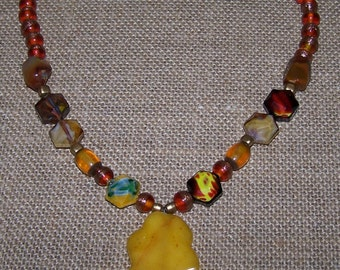 Amber color and rust color bead necklace with agate pendant