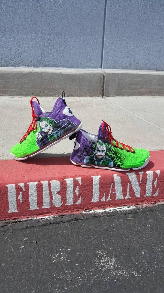 Detail view of custom Batman and Joker Nike basketball shoes