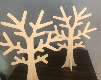 Light wooden trees display jewels