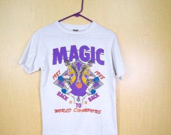 d3603579c 1908s LA Lakers Vintage T-Shirt   Back to Back World Champions   Magic  Johnson   Size SMALL   NBA Champions   Basketball   Los Angeles Tee