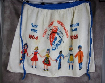 1964 New York World's Fair Terrycloth APRON It's a Small World White Terrycloth with Graphics - Made in USA