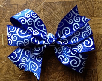 Handmade Blue and white pinwheel hairbow attached to alligator clip