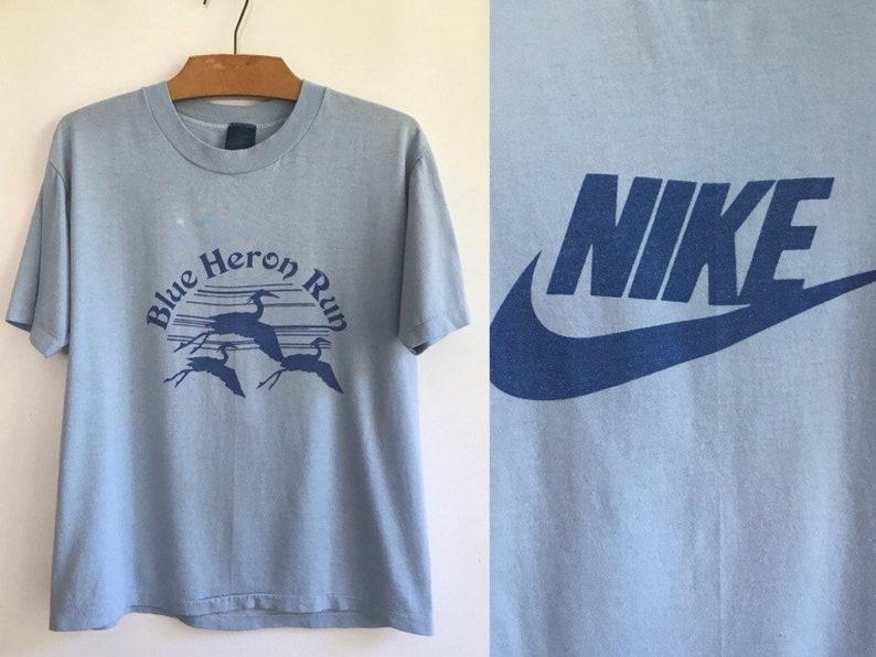 f1722b9aacefb Vintage 80s Nike Swoosh Tshirt // 1984-87 Blue Label Nike Tee // Rare  Marathon Running Shirt // Blue Heron Run // Single Stitch Old Logo