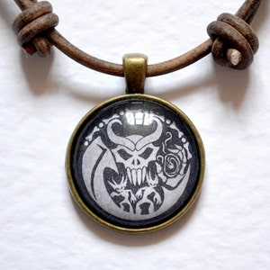 Metal scroll pendant with 18 inch leather chord