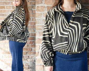 Vintage 1980s Windbreaker / Black and Gold Swirl Stripes with Metallic Speckles / Jackets Galore High Fashion / Abstract Retro Print