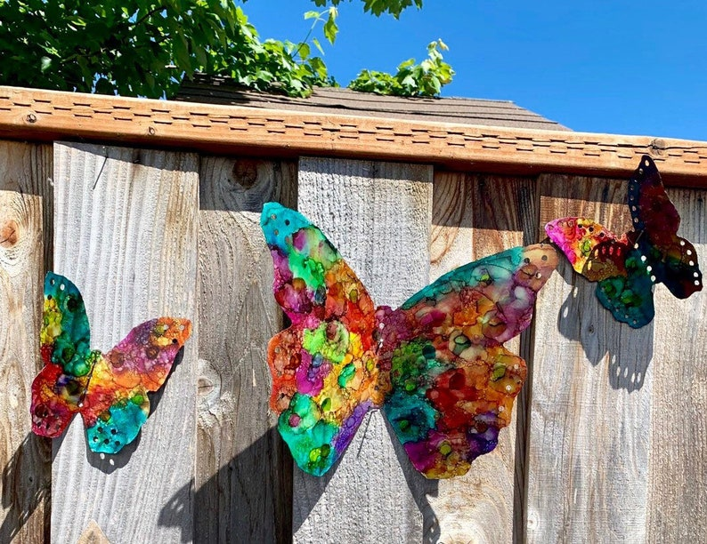 Make (or buy) metal butterflies that you can scatter across your fence to look like a flock of butterflies has invaded your yard. Here are some quick and easy ways to decorate your garden fence.