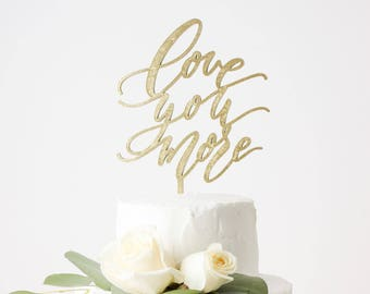 Love You More Cake Topper Laser Cut Gold Wedding Cake Topper - hand drawn and made of wood or acrylic