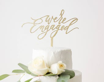 We're Engaged - Laser Cut Gold Wedding Cake Topper - hand drawn and made of wood or acrylic