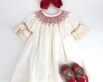 Heirloom Ivory Bishop Dress With Red Smocking