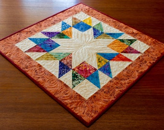Scrappy quilts - Table topper and Placemats