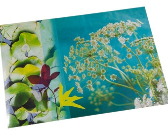 Plastic table set photo blooming wild carrots and water lilies