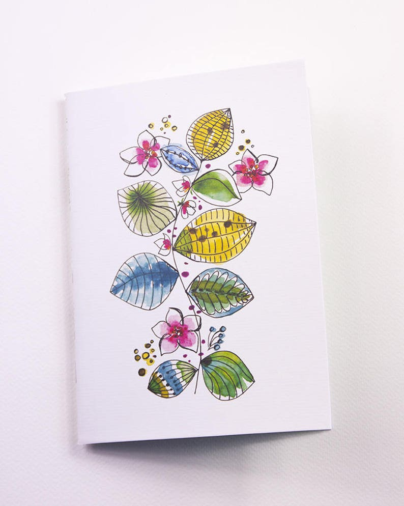Small paper leaves and watercolor flowers with a image 0