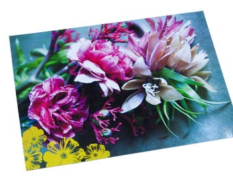 Plastic table set photo floral bouquet, pink carnations and drawing of yellow flowers