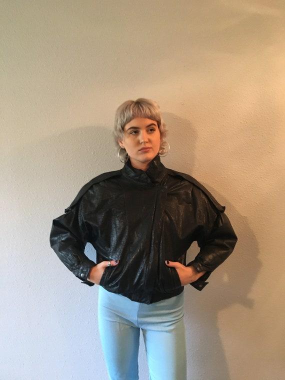 Vintage unisex black leather jacket  /size medium