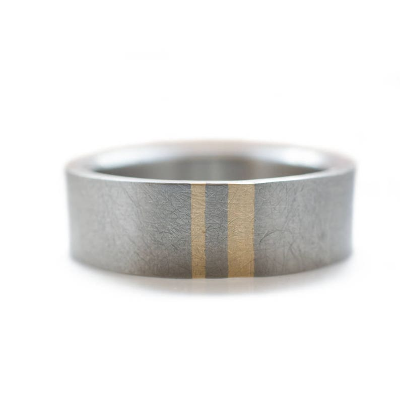 Titanium Mens wedding band with two subtle gold inlays.